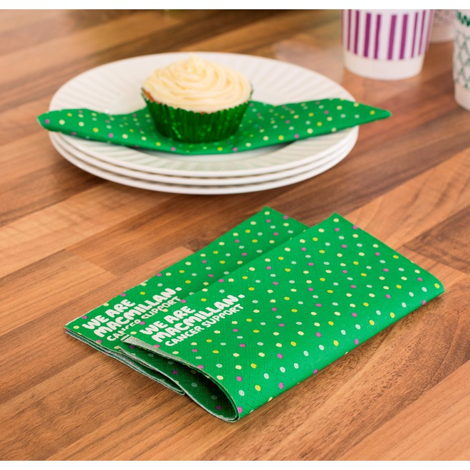 Dark green paper napkins with colourful polka dots all over.