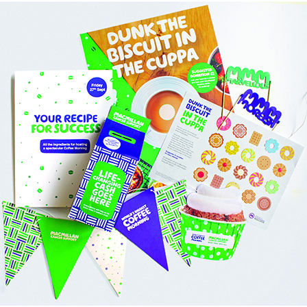 Coffee fundraising Kit filled with stickers, a money box, paper bunting, cake toppers and much more.