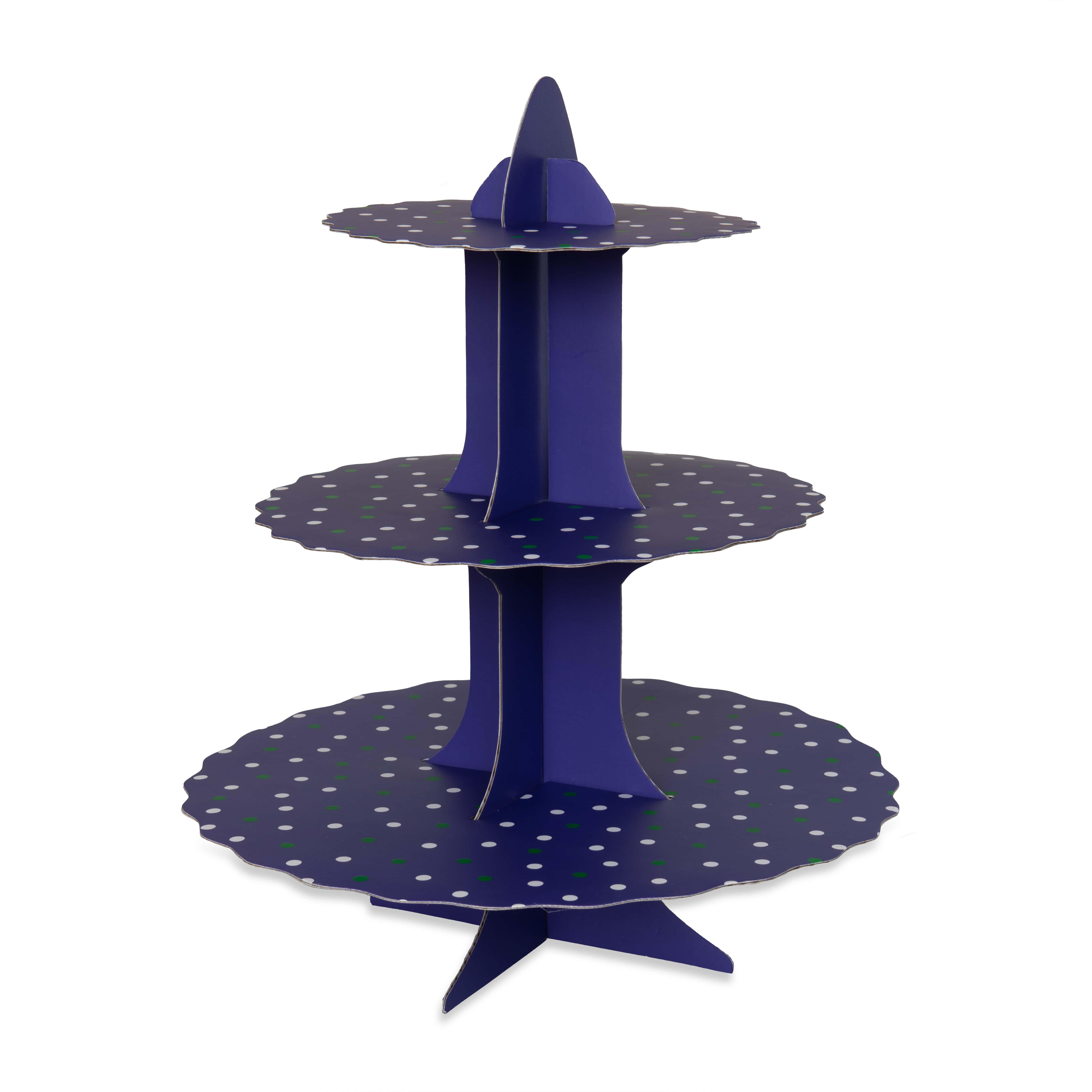 A  purple cake stand made of cardboard.