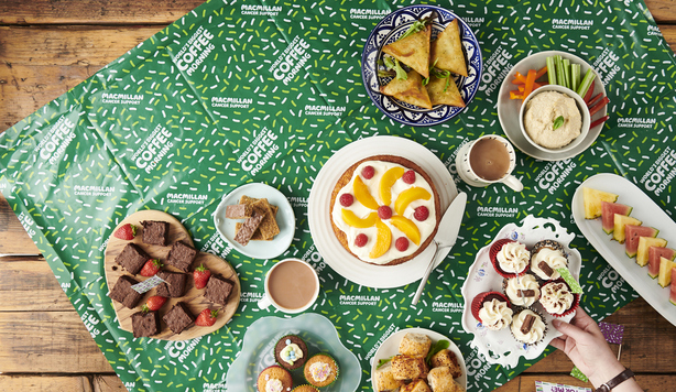 Selection of cakes and healthy snacks on a Macmillan Coffee Morning tablecloth