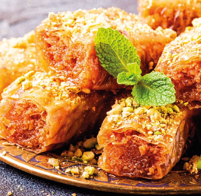 Plate of baklava topped with a sprig of mint