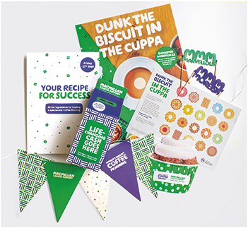 Contents of the Macmillan Coffee Kit. Money box, stickers,paper bunting, cake decorations, recipes and mroe