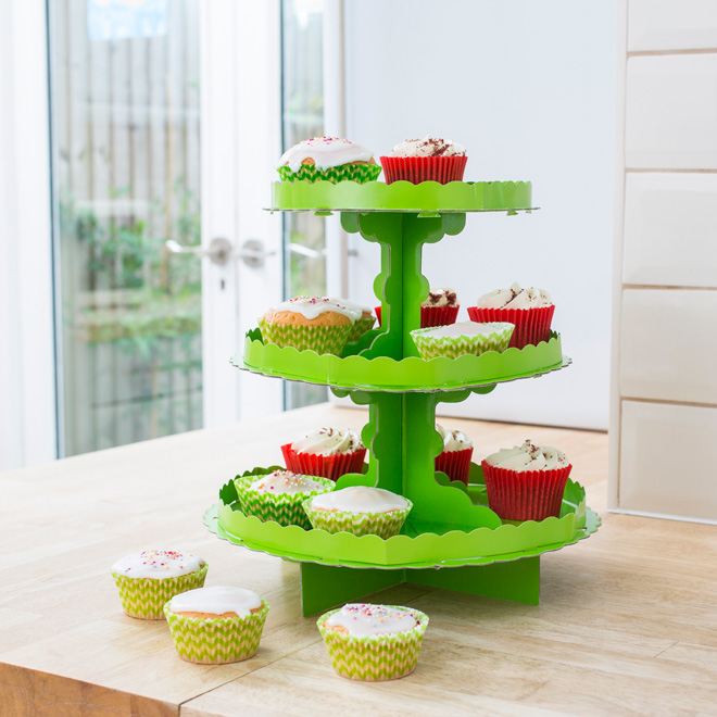Light green 3-tier cake stand full of cupcakes.