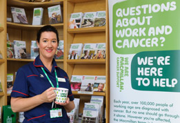 Nurse Andrea standing with a cup of coffee in a Macmillan Information Centre