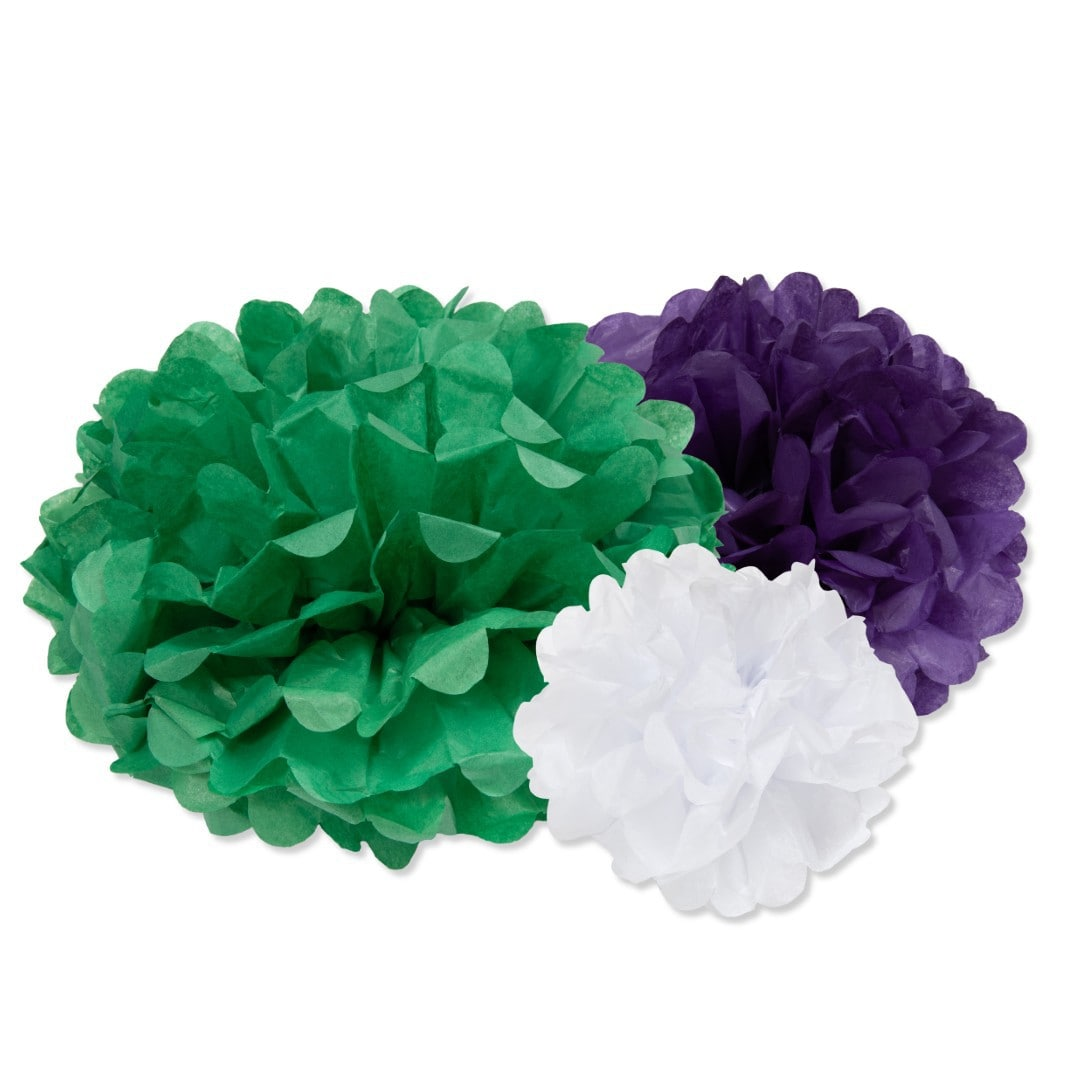 Three paper pom pom decorations in green, purple and white.