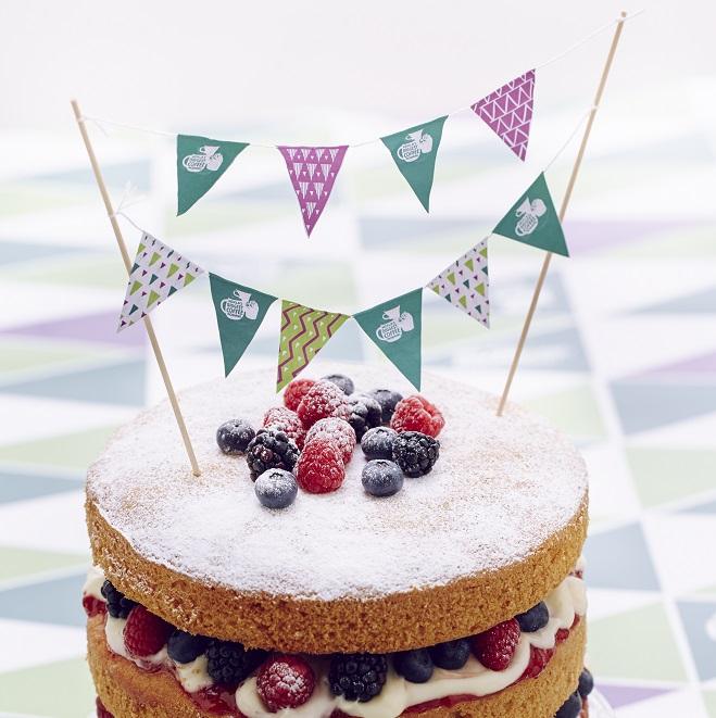 Mini Macmillan bunting on the top of a cake