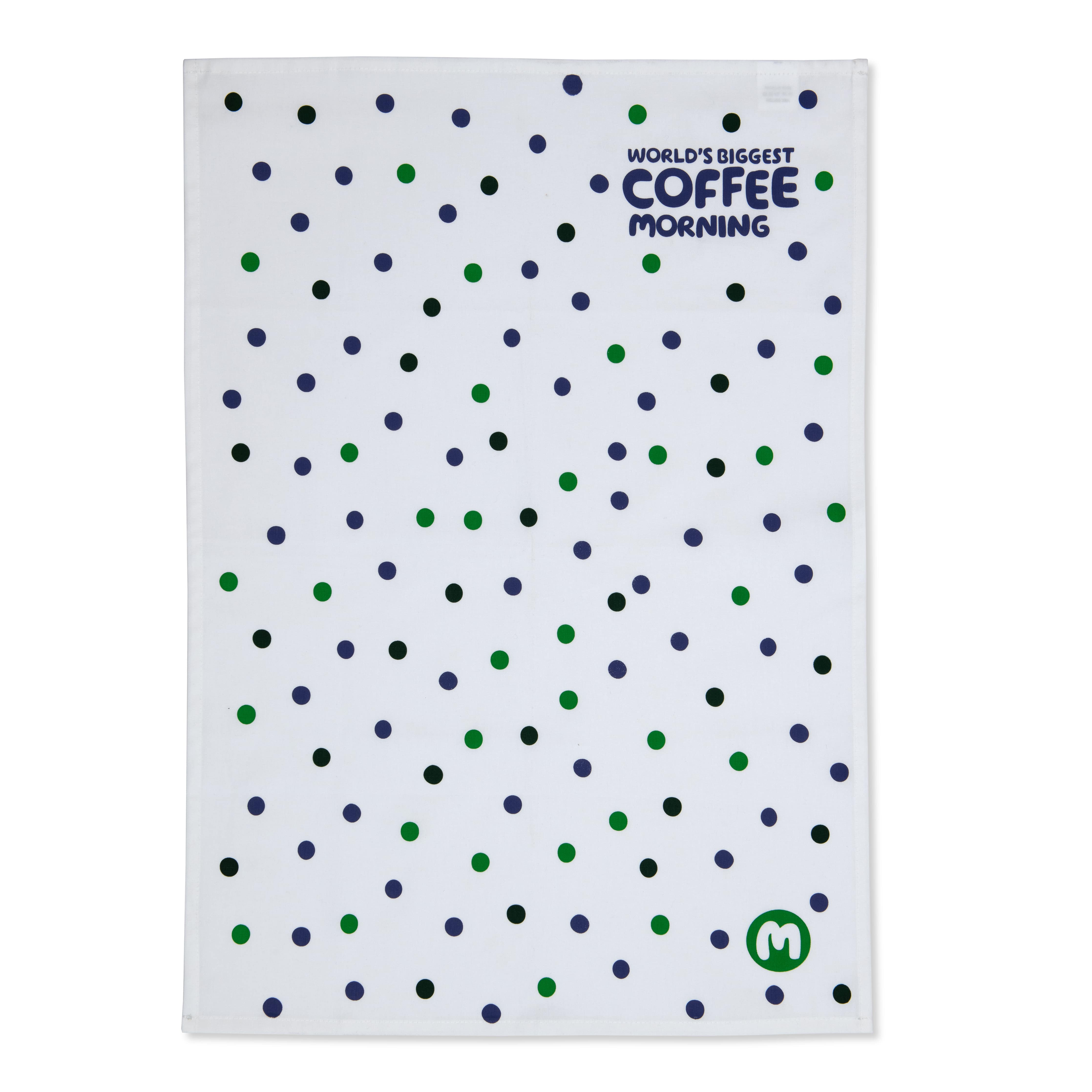 A white, green and purple spotted tea towel with 'World's biggest coffee morning' logo top right hand corner,
