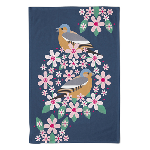 A navy tea towel with 2 chaffinches among flowers