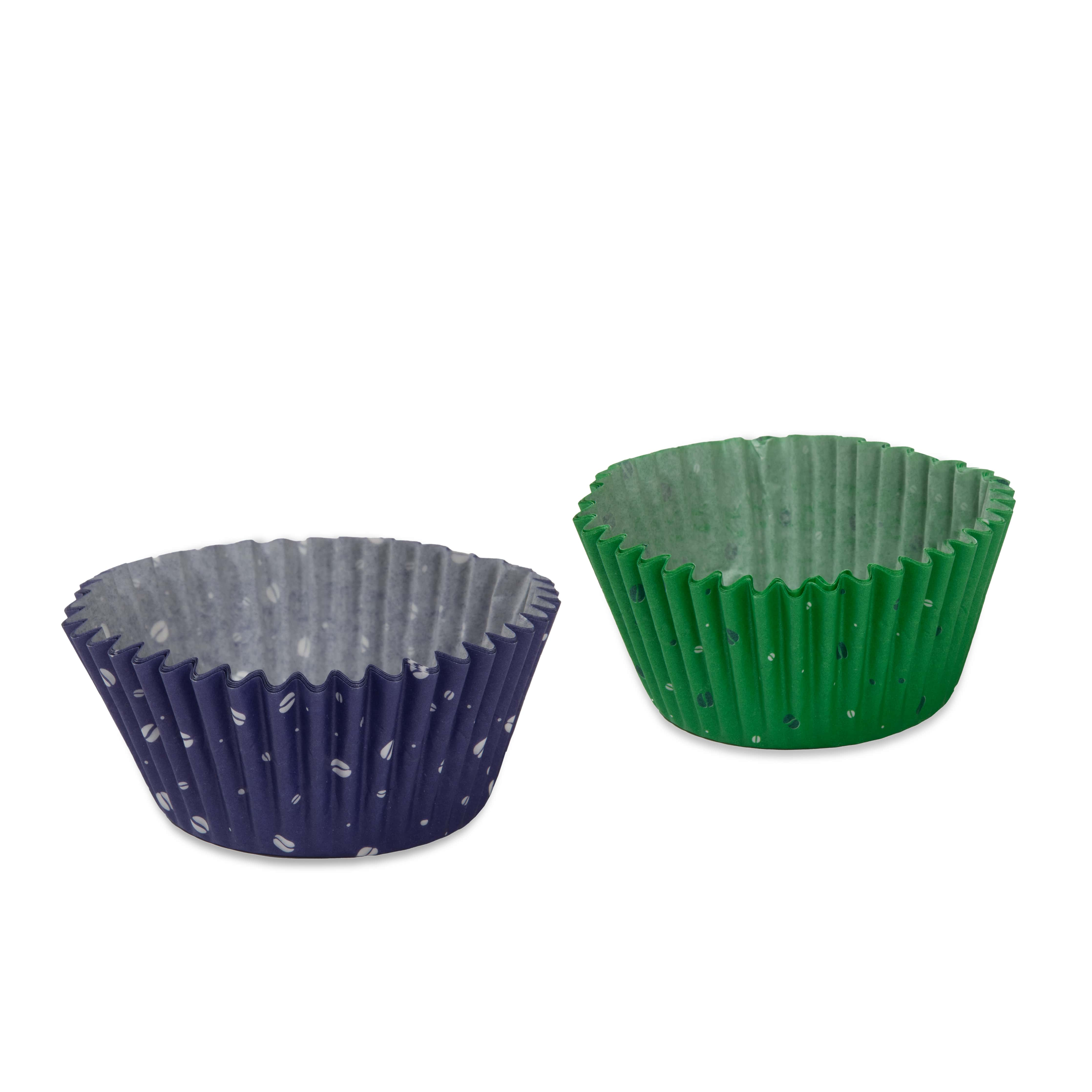 Purple cup cake case with white coffee beans. Green cup cake cases with white and purple polka dots.
