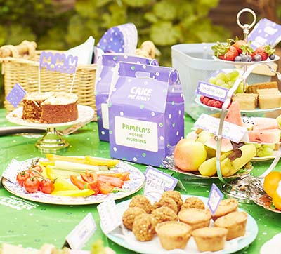 A selection of edible goods on a garden table.