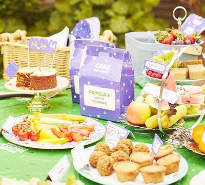 A selection of edible goods on a garden table.