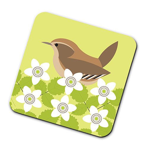 A green coaster with a bird and flowers