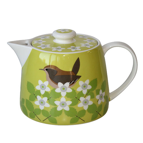 A green teapot with a bird and flowers