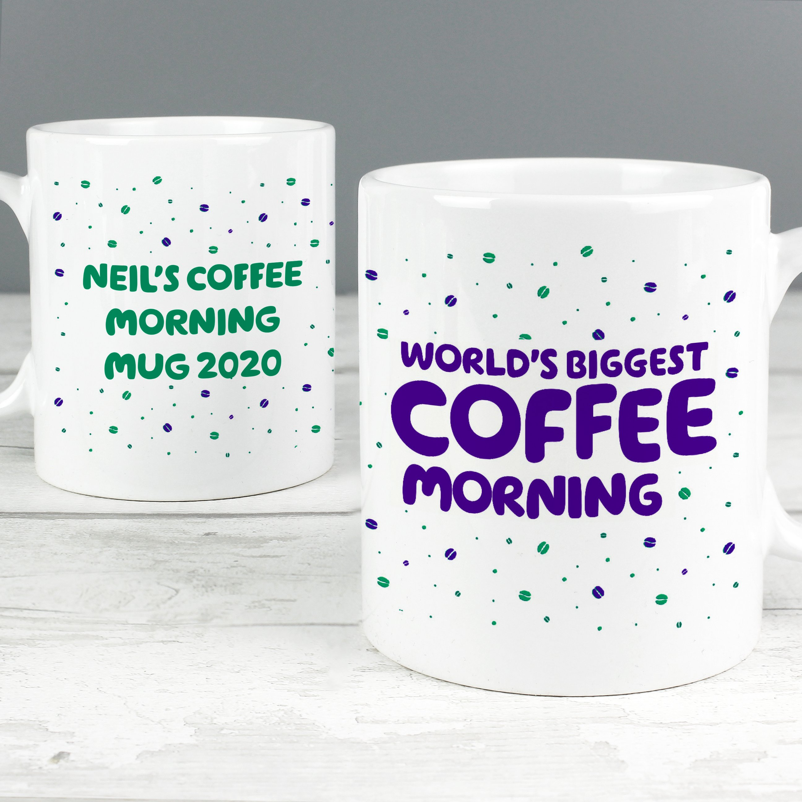 Personalised coffee morning cup that reads 'Neil's coffee morning mug 2020' on one and 'world's biggest coffee morning' on the other.